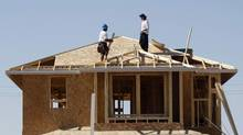 Workers construct a house by developer KB Home in Gilbert, Arizona. (JOSHUA LOTT/REUTERS)