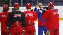 Only a few months ago, Tom Rowe, 56, a bald man with a big booming voice, never dreamed he would coach a major-league hockey team, let alone one in Russia. He's now in charge of Yaroslavl's Lokomotiv. (Mikhail Voskresensky/Globe and Mail)