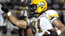 Edmonton Eskimos running back Calvin McCarty celebrates his touchdown against the Hamilton Tiger-Cats during the first half of their CFL football game in Hamilton September 16, 2011. REUTERS/Mike Cassese (Mike Cassese/Reuters)
