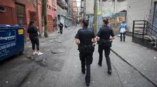 Vancouver Police officers work in the Downtown Eastside of Vancouver on July 11, 2016. (DARRYL DYCK For The Globe and Mail)