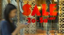 A summer sale sign is seen at Aritzia at the Eaton Centre in Toronto. (Kevin Van Paassen/The Globe and Mail)
