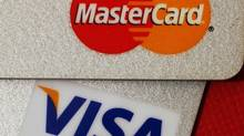 The Canadian Federation of Independent Business is among those arguing against industry rules that force businesses who accept Visa or MasterCard to treat all types of their cards equally, regardless of the cost of processing the payments. (BOBBY YIP/REUTERS)
