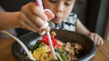 Olivia Lehmann eats cold pork ramen at Ramen Jinya, where chilled noodles are more like a salad than a soup. (John Lehmann/The Globe and Mail)