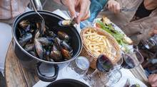 Binge on steamed mussels with fries and wine in France. (Magryt/Getty Images/iStockphoto)