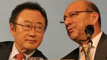 Sakong Il, left, of South Korea, chairman of the presidential committee for the G20, talks with South Africa's Trevor Manuel during a joint press conference at the meeting in Busan, South Korea, of the G20 finance ministers and central bank governors. (KIM JAE-HWAN/AFP/Getty Images)