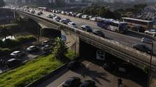 Sao Paulo's airport, roads and public transit are all desperate for investment. The number of cars on the road has soared to seven million, leading to serious traffic congestion. (Nacho Doce/Reuters/Nacho Doce/Reuters)