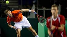 Canada's Daniel Nestor, left, of Toronto, Ont., serves while playing with Vasek Pospisil against Spain's Marcel Granollers and Marc Lopez during a Davis Cup tennis world group first-round tie doubles match in Vancouver, B.C., on Saturday February 2, 2013. (The Canadian Press)