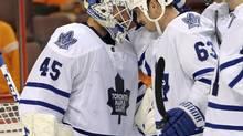 Toronto Maple Leafs goalie Jonathan Bernier (45) and center Dave Bolland (63) celebrate win over the Philadelphia Flyers at the Wells Fargo Center. (Eric Hartline/USA TODAY Sports)