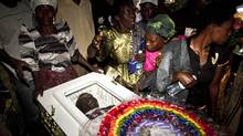 Members of the Ugandan gay community attend a funeral of a murdured activist David Kato, at his parental home close to the town of Mataba on January 28, 2011. Although the police claims it was most likely a petty crime, targeting Kato's money, many members of the gay and the human rights community hold the Ugandan government responsible for not battling the growing resentments against homosexuals in the Ugandan society. Homosexuality is illegal in many African countries and is punishable by a prison sentence. (MARC HOFER/AFP/Getty Images)