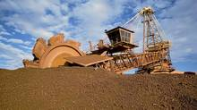 A loader prepares to shovel iron ore dug from an Australian mine in this undated handout picture from Port Hedland. BHP Billiton and other Australian miners sell hundreds of millions of tonnes of ore annually to steel mills worldwide. This year China's steelmakers want a big discount to compensate for weaker steel sales at home. (REUTERS/BHP Billiton/REUTERS/BHP Billiton)