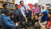 Finance Minister Bill Morneau takes part in the pre-budget ceremony of putting on new shoes at the Nelson Mandela Park Public School in Toronto on Monday. (Mark Blinch/THE CANADIAN PRESS)