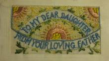 The cloth postcard with pouch that Melvin Flynn Macleod sent home from France during World War I to his infant daughter, Ruth. The item has a pouch for inserting a letter. (Courtesy of Anne Munro)