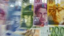 Varoius Euro banknotes lay next to various Swiss Franc notes in this picture illustration at a bank in Warsaw, July 18, 2011. (REUTERS/KACPER PEMPEL/REUTERS/KACPER PEMPEL)