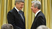 Jean-Pierre Blackburn shakes hands with Prime Minister Stephen Harper after being sworn in as Veterans Affairs Minister at Rideau Hall on Jan. 19, 2010. (Pawel Dwulit/Pawel Dwulit/The Canadian Press)