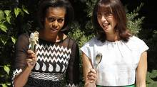 First Lady Michelle Obama, left, and Samantha Cameron, wife of British Prime Minister David Cameron, wait to serve lunch to U.S. and British military service members, veterans and family members in a courtyard at 10 Downing Street in London May 25, 2011. (LARRY DOWNING/Larry Downing/Reuters)