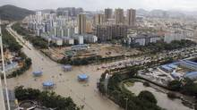 A view of flooded streets after rainstorms triggered by Typhoon Haiyan hit Sanya, Hainan province November 11, 2013. Rainstorms from the typhoon hit the south China region on Sunday and Monday, killing at least four, with seven people still missing, according to Xinhua News Agency. Haiyan, one of the most powerful storms ever recorded, killed an estimated 10,000 people in central Philippines, according to officials. Picture taken November 11, 2013. (Stringer/REUTERS)