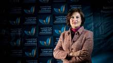 In this March 2014 image released by the National Dialogue Preparatory Commission, Salwa Bugaighis, lawyer and rights activist, poses for a photograph during a meeting in Tripoli, Libya. (Uncredited/THE ASSOCIATED PRESS)