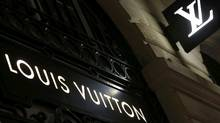 Logos of the Louis Vuitton brand are seen outside a Louis Vuitton store in Bordeaux, southwestern France, October 4, 2016. (REGIS DUVIGNAU/REUTERS)