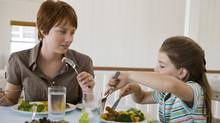 Kids who ate regularly with the rest of their family were 24 per cent more likely to eat healthy foods, according to a recent study. (iStockphoto/iStockphoto)