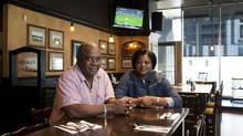 Neville Lowe and his wife, Beverly Samuel-Lowe, took on a Fionn MacCool's pub on Front Street West in Toronto after getting restless in retirement. (Matthew Sherwood For The Globe and Mail)