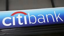 A Citibank sign hangs above a branch office in New York. (Mark Lennihan/AP)