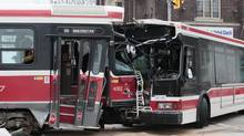A TTC streetcar collided with a bus at the intersection of Danforth Ave. and Main St. in Toronto on Dec. 27. (JOHN HANLEY FOR THE GLOBE AND MAIL)