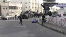 A still image from a video supplied by Saudi human-rights activists shows armoured vehicles being used against Shia Muslim dissidents. The footage casts doubt on Ottawa's assurances that the delivery of Canadian-made LAVs would not endanger Saudi civilians. (European-Saudi Organisation for Human Rights)