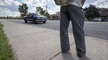 After getting off a TTC bus at Danforth Road and Linden Avenue, pedestrians wait for traffic to clear before crossing to the other side. (Fred Lum/The Globe and Mail)