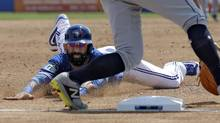 Toronto Blue Jays' Jose Bautista attempts a steal in the second inning of a game against the Tampa Bay Rays Sunday in Dunedin, Fla. (Chris O'Meara/AP)