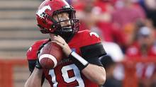 Calgary Stampeders quarterback Bo Levi Mitchell looks to pass against the BC Lions on July 29, 2016. (Jeff McIntosh/THE CANADIAN PRESS)
