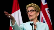 Ontario Premier Kathleen Wynne speaks to media at Queen's Park Toronto, Ontario, Tuesday, January 6, 2015.