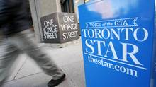 A pedestrian walks past a Toronto Star newspaper box in front of the Toronto Star building in Toronto. (MARK BLINCH/REUTERS)
