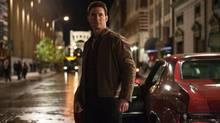 """Tom Cruise in a scene from """"Jack Reacher."""" Cruise plays a former military cop investigating a sniper case. (Karen Ballard/AP)"""