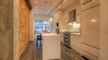 The birthplace of actress Beatrice Lillie, 68 Dovercourt Rd. has been totally renovated into a 'bright and open' home in the Beaconsfield Village neighbourhood of Toronto. (Mark Wilson/realhomephoto.com)