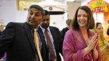 Leader of the Wildrose Party Danielle Smith (R) and Wildrose MLA Prasad Panda meet with members of the Hindu community during a campaign stop at a Hindu Temple in Calgary, Alberta, April 15, 2012. (TODD KOROL/REUTERS/TODD KOROL/REUTERS)