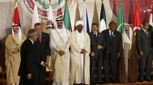Heads of Arab states gather ahead of a group photo during the opening of the Arab League summit in Doha March 26, 2013. A summit of Arab heads of state opened in the Qatari capital Doha on Tuesday expected to focus on the war in Syria as well as on the Israeli-Palestinian conflict. (AHMED JADALLAH/REUTERS)