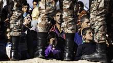 Syrian refugees wait to cross the Jordanian Hadalat border from their makeshift camp near the city of Ruwaished on Jan. 14, 2016. (Annie Sakkab)