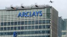 The letter 'B' of the signage on the Barclays headquarters in Canary Wharf is hoisted up the side of the building in London July 20, 2012. (SIMON NEWMAN/REUTERS)