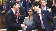 Prime Minister Justin Trudeau, right, shakes hands with Minister of Finance Bill Morneau following his federal budget speech in the House of Commons on Parliament Hill in Ottawa on Tuesday, March 22, 2016.