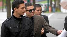 Stanley Cup rioter Emmanuel Alviar, centre, walks with supporters as he arrives at Provincial Court for his sentencing in Vancouver, B.C., on May 3, 2012. (Darryl Dyck for The Globe and Mail/Darryl Dyck for The Globe and Mail)