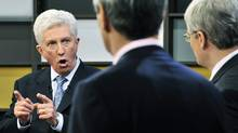 Bloc Quebecois Leader Gilles Duceppe, left, speaks as Liberal Leader Michael Ignatieff, centre, and Conservative Leader Stephen Harper listen during the French-language leaders' debate in Ottawa. (Sean Kilpatrick/Pool/Reuters)