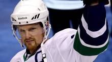 Vancouver Canucks' Henrik Sedin, of Sweden, waves to the crowd after he was named captain of the NHL hockey team prior to their home opener against the Los Angeles Kings in Vancouver, B.C., on Saturday October 9, 2010. THE CANADIAN PRESS/Darryl Dyck (DARRYL DYCK)