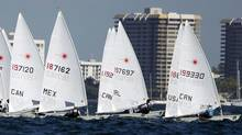 A group of Laser class boats begin their race at the Miami Olympic Classes Regatta on Biscayne Bay in Miami, Wednesday, Jan. 25, 2012. More than 500 sailors from 44 countries are competing in the stepping stone to the Olympic games.(AP Photo/J Pat Carter) (J Pat Carter/AP)