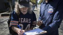 West End resident Ben Lynh signs a petition to decriminalize marijuana Sept. 9. Sensible BC hopes to collect more than 400,000 signatures to force a provincial referendum. (John Lehmann/The Globe and Mail)