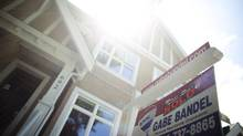 A sold sign in the Fairview slopes neighbourhood in Vancouver on June 9, 2013. (Rafal Gerszak for The Globe and Mail)