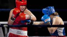 Ontario's Mary Spencer, left, battles Quebec's Ariane Fortin to win the 75kg event at the Canadian boxing championships in Sydney, N.S. on Friday, Jan. 13, 2012. (Andrew Vaughan/The Canadian Press)