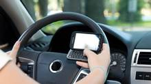 Texting and Driving (Lisa F. Young/Getty Images/iStockphoto)