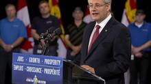 Prime Minister Stephen Harper addresses the audience at Vector Aerospace in Summerside, PEI on Tuesday, May 14, 2013. The Harper government is spending hundreds of thousands of dollars advertising a program that does not yet exist. (Andrew Vaughan/The Canadian Press)