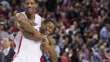 Toronto Raptors teammates DeMar DeRozan, left, and Kyle Lowry, right, celebrate after defeating the Atlanta Hawks 96-86 in NBA action in Toronto on Sunday, March 23, 2014. (Nathan Denette/THE CANADIAN PRESS)