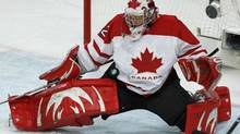 Canada's goaltender Charline Labonte makes a save during the third period of their women's preliminary ice hockey game against Sweden at the Vancouver 2010 Winter Olympics, February 17, 2010. (LYLE STAFFORD/REUTERS)